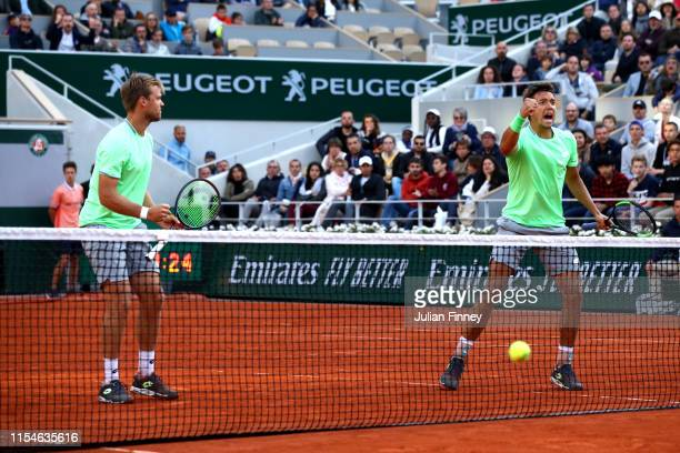 Kevin Krawietz of Germany and partner Andreas Mies of Germany celebrate match point during the mens doubles final against Jeremy Chardy of France and...
