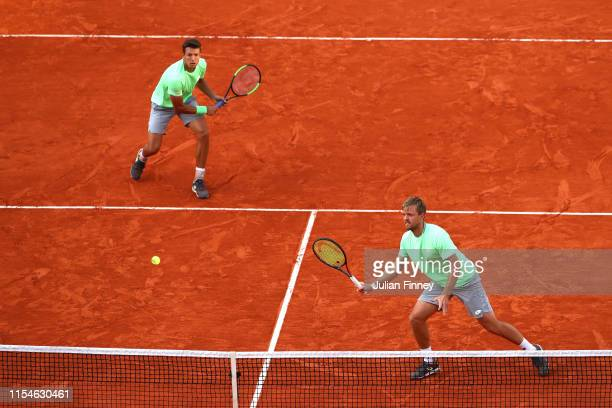 Kevin Krawietz of Germany and partner Andreas Mies of Germany return the ball during the mens doubles final against Jeremy Chardy of France and...