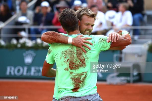 Kevin Krawietz of Germany and partner Andreas Mies of Germany celebrate victory during the mens doubles final against Jeremy Chardy of France and...