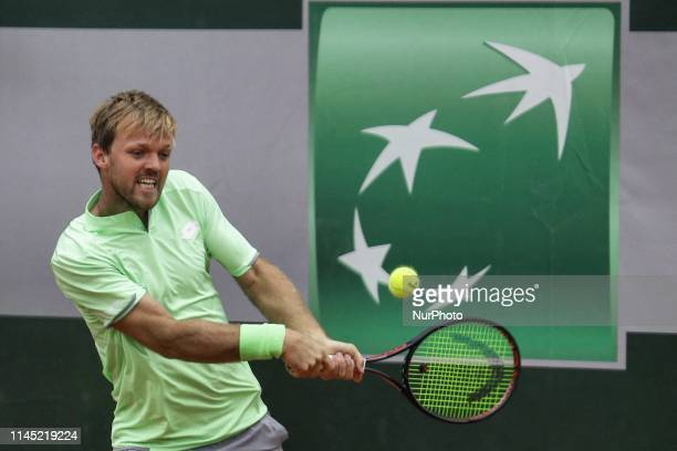 Kevin Krawietz of Germany hits a return during his men's singles against former world No12 the Serbian Victor Troicki in the first round of Roland...