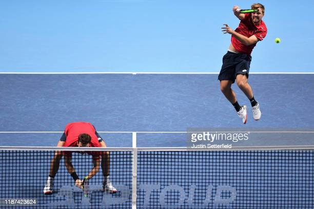 Kevin Krawietz of Germany playing partner of Andreas Mies of Germany plays a forehand volley in their doubles match against Nicolas Mahut and...