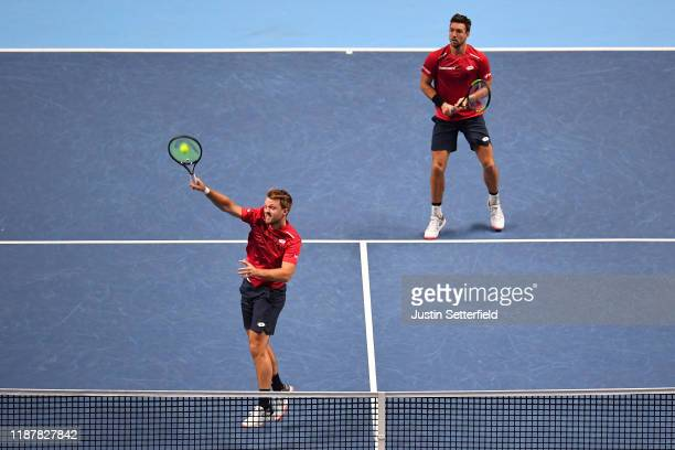 Kevin Krawietz of Germany playing partner of Andreas Mies of Germany plays a forehand in their doubles match against Juan Sebastian Cabal and Robert...