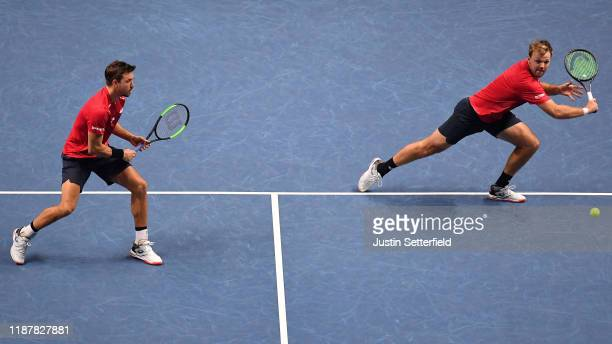 Kevin Krawietz of Germany playing partner of Andreas Mies of Germany plays a backhand in their doubles match against Juan Sebastian Cabal and Robert...