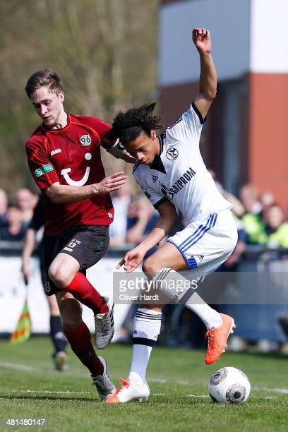 Kevin Krottke of Hannover and Leroy Sane of Schalke compete for the ball during the DFB Junioren Pokal Semifinal match between Hannover 96 and FC...