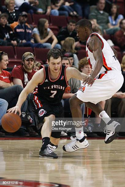 Kevin Kruger of the Utah Flash drives past Mike Taylor of the Idaho Stampede during the DLeague game on March 29 2008 at Qwest Arena in Boise Idaho...