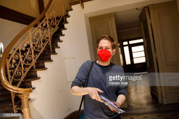 Kevin Kuehnert, deputy SPD leader, walks in a stairwell of a residential building during the launch of the SPD's door-to-door campaigning ahead of...