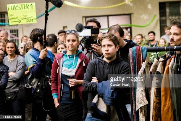 Kevin Kuehnert head of the JuSos the youth wing of the German Social Democrats listens to residents of an apartment building who fear their...