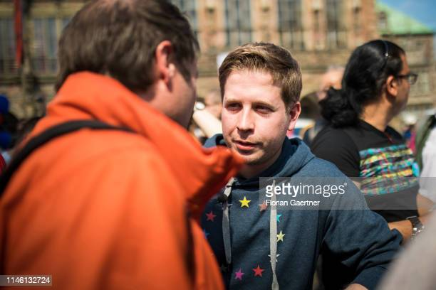 Kevin Kuehnert Head of the Young Socialists talks with visitors during the finish of the SPD electioneering for the European Parliament and the...