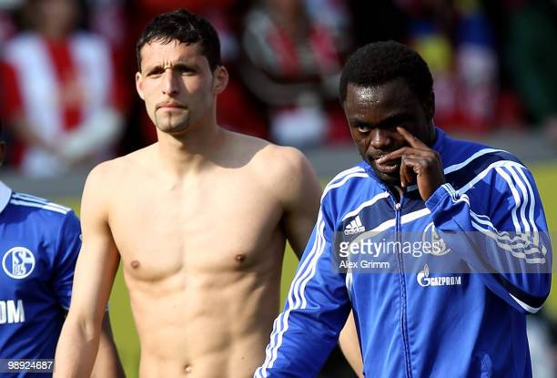 Kevin Kuranyi and Gerald Asamoah of Schalke react as they leave the pitch after the Bundesliga match between FSV Mainz 05 and FC Schalke 04 at the...
