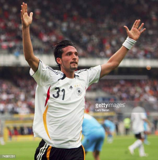Kevin Kuranyi celebrates scoring the first goal during the UEFA EURO 2008 qualifier between Germany and San Marino at the Easy Credit Stadium on June...