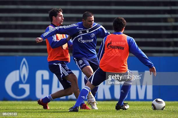 Kevin Kuranyi challenges Edu during a FC Schalke 04 training session on April 13 2010 in Gelsenkirchen Germany