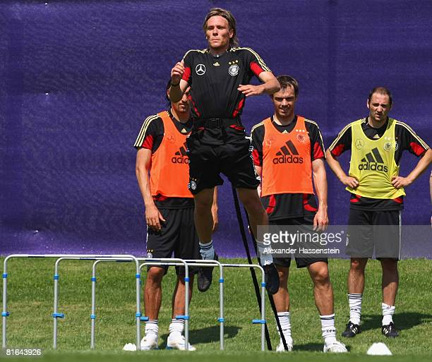 Kevin Kuranyi Clemens Fritz Heiko Westermann and Oliver Neuville of Germany in action during a training session at the Centro Sportivo Tenero on June...