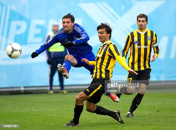 Kevin Kuranyi of FC Dynamo Moscow battles for the ball with Azat Bairyye of FC Alania Vladikavkaz during the Russian Premier League match between FC...