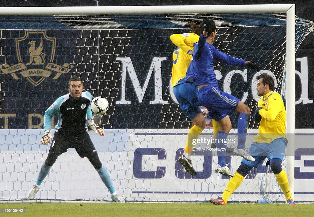 Kevin Kuranyi (2nd R) of FC Dynamo Moscow scores the opening goal past goalkeeper Stipe Pletikosa (L) of FC Rostov Rostov-on-Don during the Russian Premier League match between FC Dynamo Moscow and FC Rostov Rostov-on-Don at the Arena Khimki Stadium on March 30, 2013 in Khimki, Russia.