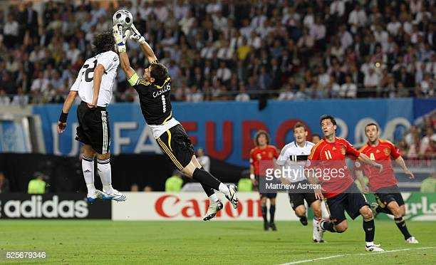 Kevin Kuranyi of Germany and Iker Casillas of Spain go for the ball during the Euro 2008 European Soccer Championships final match between Gemany and...
