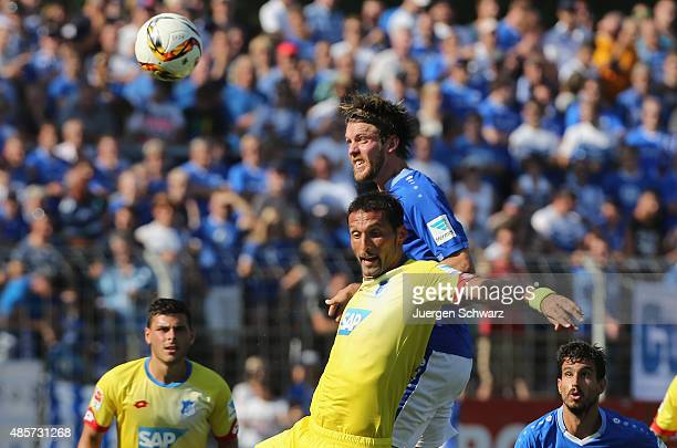 Kevin Kuranyi of Hoffenheim and Peter Niemeyer of Darmstadt jump for the ball during the Bundesliga match between SV Darmstadt 98 and 1899 Hoffenheim...