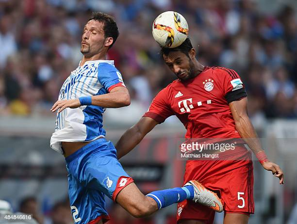 Kevin Kuranyi of Hoffenheim jumps for a header with Medhi Benatia of Muenchen during the Bundesliga match between 1899 Hoffenheim and FC Bayern...