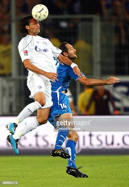 Kevin Kuranyi of Schalke and Josip Simunic of Hoffenheim go up for a header during the Bundesliga match between 1899 Hoffenheim and FC Schalke 04 at...