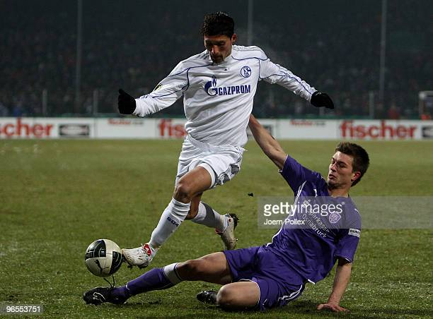 Kevin Kuranyi of Schalke and Oliver Stang of Osnabrueck battle for the ball during the DFB Cup quarter final match between VfL Osnabrueck and FC...