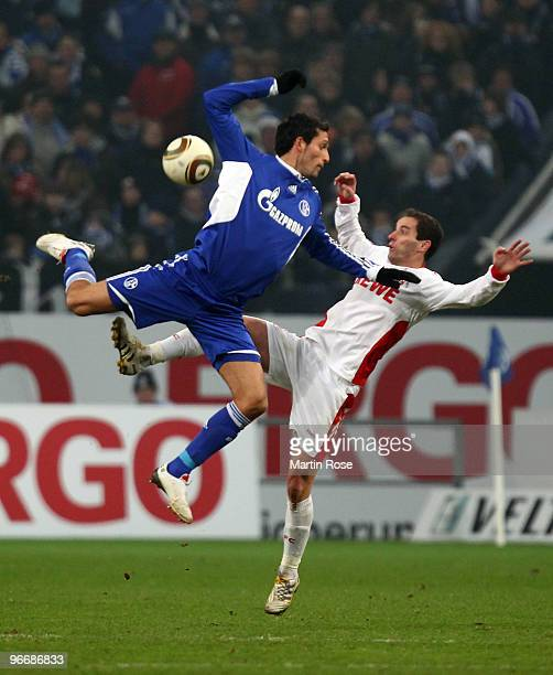 Kevin Kuranyi of Schalke and Petit of Koeln battle for the ball during the Bundesliga match between FC Schalke 04 and 1 FC Koeln at the Veltins Arena...