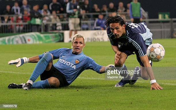 Kevin Kuranyi of Schalke and Santiago Canizares of Valencia battle for the ball during the UEFA Champions League Group B match between Schalke 04 and...