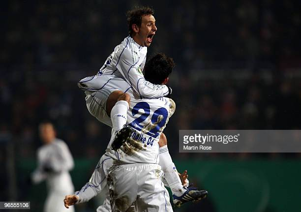 Kevin Kuranyi of Schalke celebrate with team mate Rafinha after he scores his team's 1st goal during the DFB Cup quarter final match between VfL...