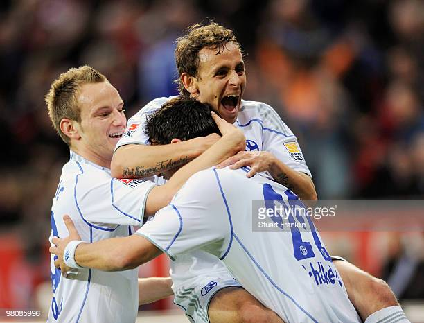 Kevin Kuranyi of Schalke celebrates after scoring his team's first goal with team matesIvan Rakitic and Rafinha during the Bundesliga match between...