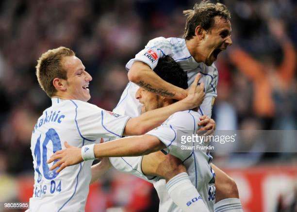 Kevin Kuranyi of Schalke celebrates scoring his team's first goal with team mates Ivan Rakitic and Rafinha during the Bundesliga match between Bayer...