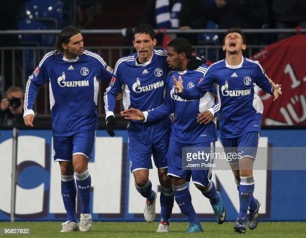 Kevin Kuranyi of Schalke celebrates with his team mates Edu Jefferson Farfan and Rafinha after scoring his team's first goal during the Bundesliga...