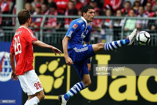 Kevin Kuranyi of Schalke controles the ball ahead of Niko Bungert of Mainz during the Bundesliga match between FSV Mainz 05 and FC Schalke 04 at the...