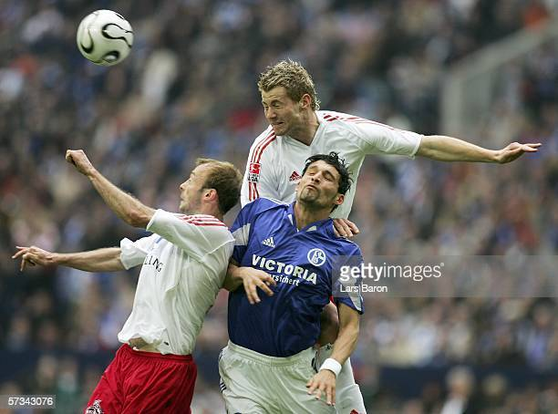 Kevin Kuranyi of Schalke goes up for a header with Carsten Cullmann and Lukas Sinkiewicz of Cologne during the Bundesliga match between Schalke 04...