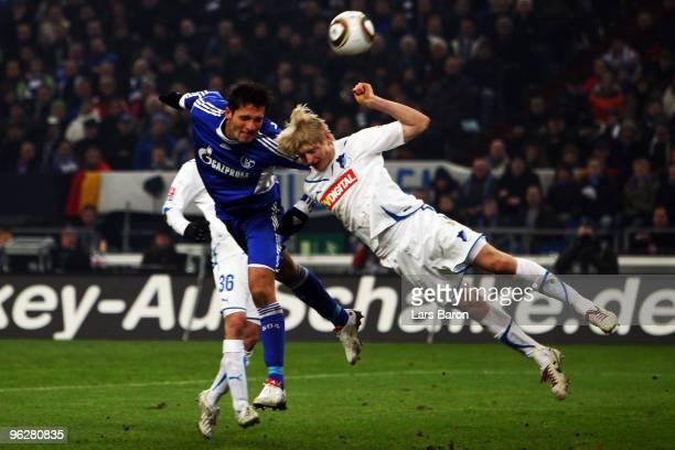 Kevin Kuranyi of Schalke heads the ball next to Andreas Beck of Hoffenheim during the Bundesliga match between FC Schalke 04 and 1899 Hoffenheim at...