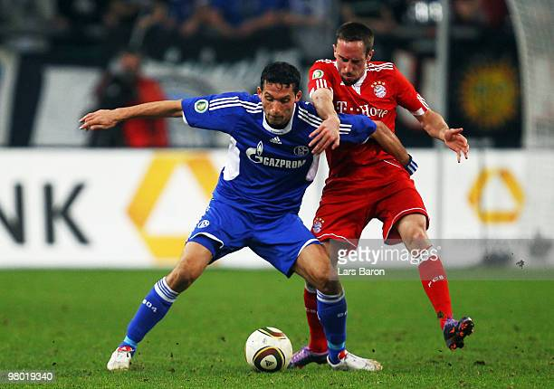 Kevin Kuranyi of Schalke is challenged by Franck Ribery of Muenchen during the DFB Cup semi final match between FC Schalke 04 and FC Bayern Muenchen...