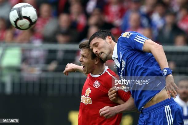 Kevin Kuranyi of Schalke jumps for a header with Radoslav Zabavnik of Mainz during the Bundesliga match between FSV Mainz 05 and FC Schalke 04 at the...