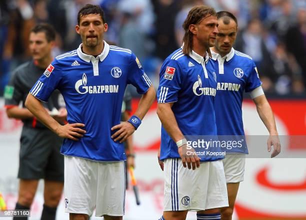 Kevin Kuranyi of Schalke Marcelo Bordon and Heiko Westermann look dejected after losing 02 the Bundesliga match between FC Schalke 04 and SV Werder...