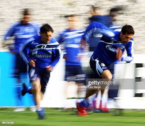 Kevin Kuranyi runs next to Vicente Sanchez during a FC Schalke 04 training session on April 13 2010 in Gelsenkirchen Germany
