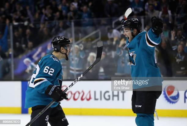 Kevin Labanc and Tomas Hertl of the San Jose Sharks celebrate after Labanc scored the gamewinning goal in overtime against the Vancouver Canucks at...