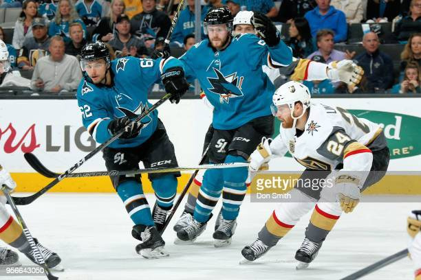 Kevin Labanc Chris Tierney of the San Jose Sharks and Oscar Lindberg of the Vegas Golden Knights chase the puck in Game Six of the Western Conference...