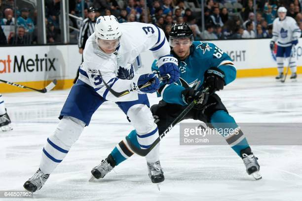 Kevin Labanc of the San Jose Sharks and Alexey Marchenko of the Toronto Maple Leafs battle for the puck at SAP Center at San Jose on February 28 2017...