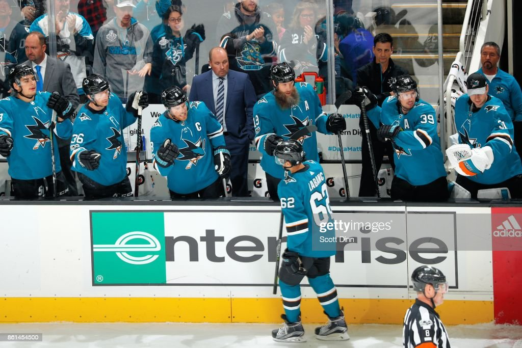 Kevin Labanc #62 of the San Jose Sharks celebrates his first period goal with teammates during a NHL game against New York Islanders at SAP Center on October 14, 2017 in San Jose, California.