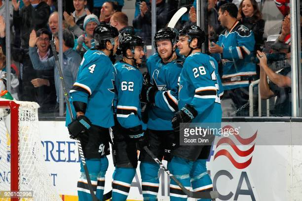 Kevin Labanc of the San Jose Sharks celebrates his second period goal against the Chicago Blackhawks with teammates Brenden Dillon Chris Tierney and...