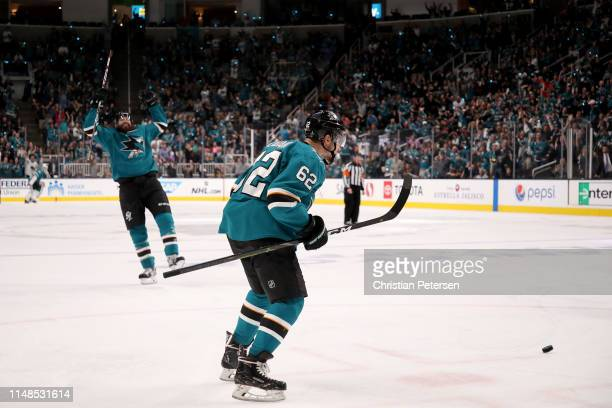 Kevin Labanc of the San Jose Sharks celebrates with Brent Burns after scoring a goal on Jordan Binnington of the St Louis Blues during the second...