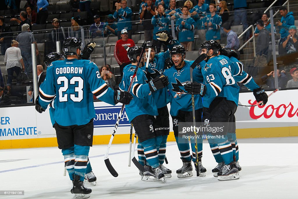 Kevin Labanc #62 of the San Jose Sharks celebrates with teammates after scoring the winning goal against the Vancouver Canucks at SAP Center on September 27, 2016 in San Jose, California.