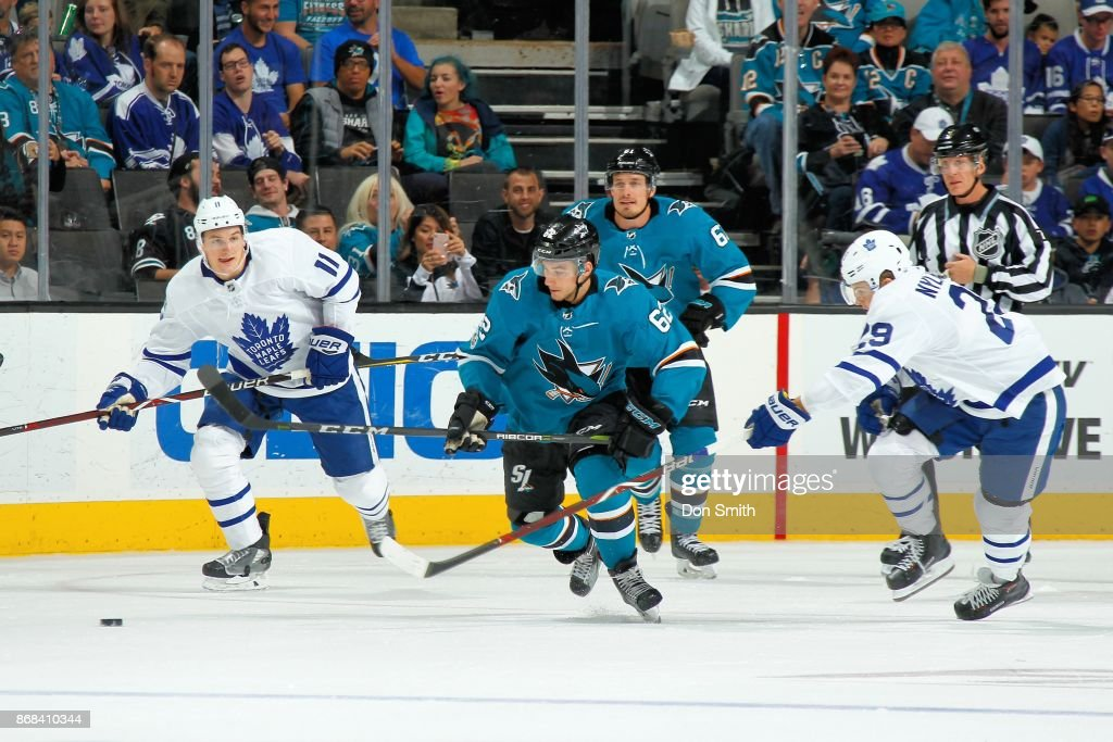 Kevin Labanc #62 of the San Jose Sharks chases the puck with Zach Hyman #11 and William Nylander #29 of the Toronto Maple Leafs at SAP Center on October 30, 2017 in San Jose, California.