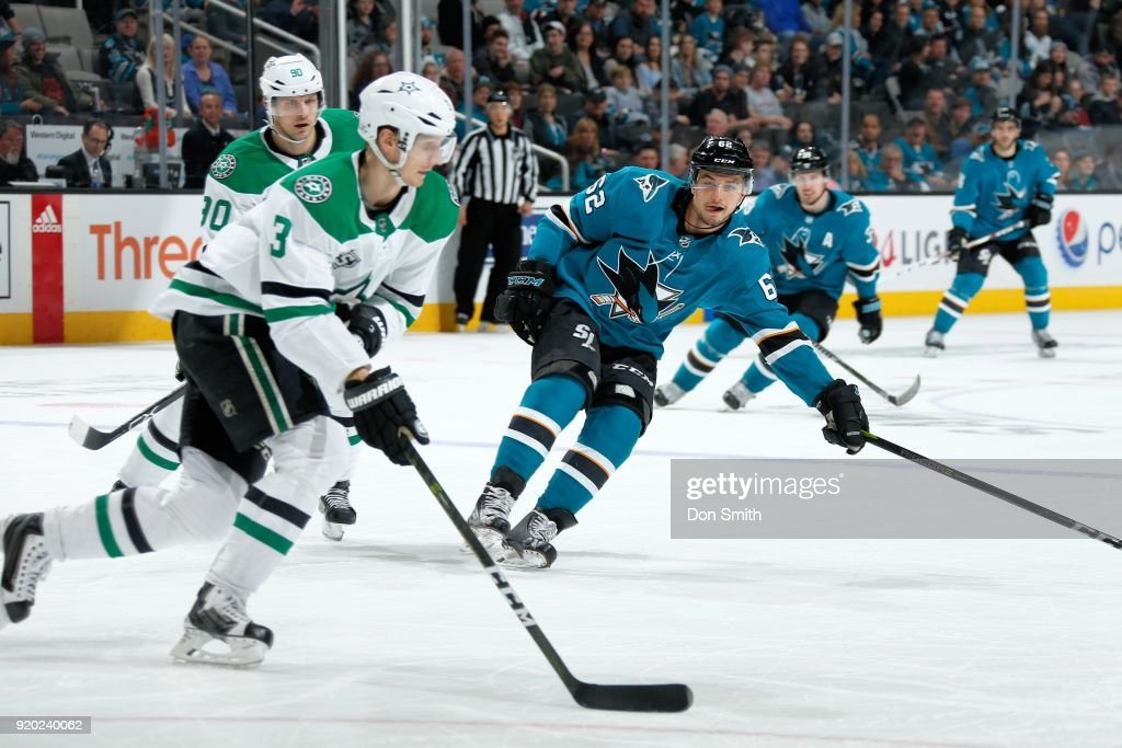 Kevin Labanc #62 of the San Jose Sharks defends John Klingberg #3 of the Dallas Stars at SAP Center on February 18, 2018 in San Jose, California.