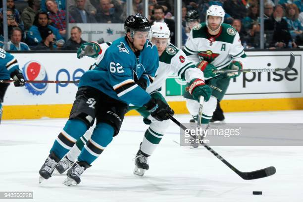 Kevin Labanc of the San Jose Sharks is defended by Charlie Coyle of the Minnesota Wild at SAP Center on April 7 2018 in San Jose California