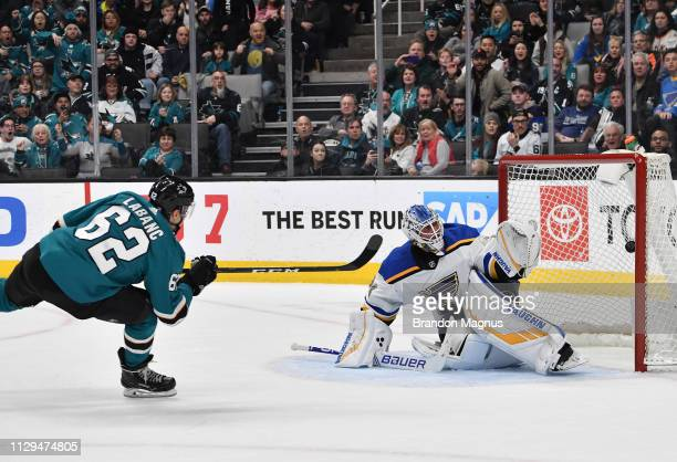 Kevin Labanc of the San Jose Sharks scores to win the game in overtime against the St Louis Blues at SAP Center on March 9 2019 in San Jose California