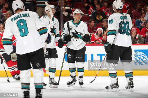 Kevin Labanc of the San Jose Sharks stands with teammates after scoring against the Chicago Blackhawks in the third period at the United Center on...
