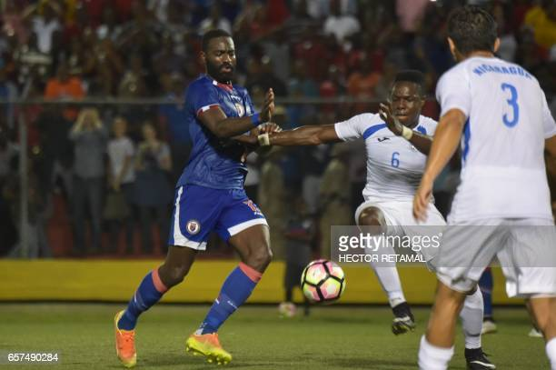Kevin Lafrance of Haiti vies for the ball with Luis Copete of Nicaragua during the first of two match to define the last qualified to the 2017 Gold...