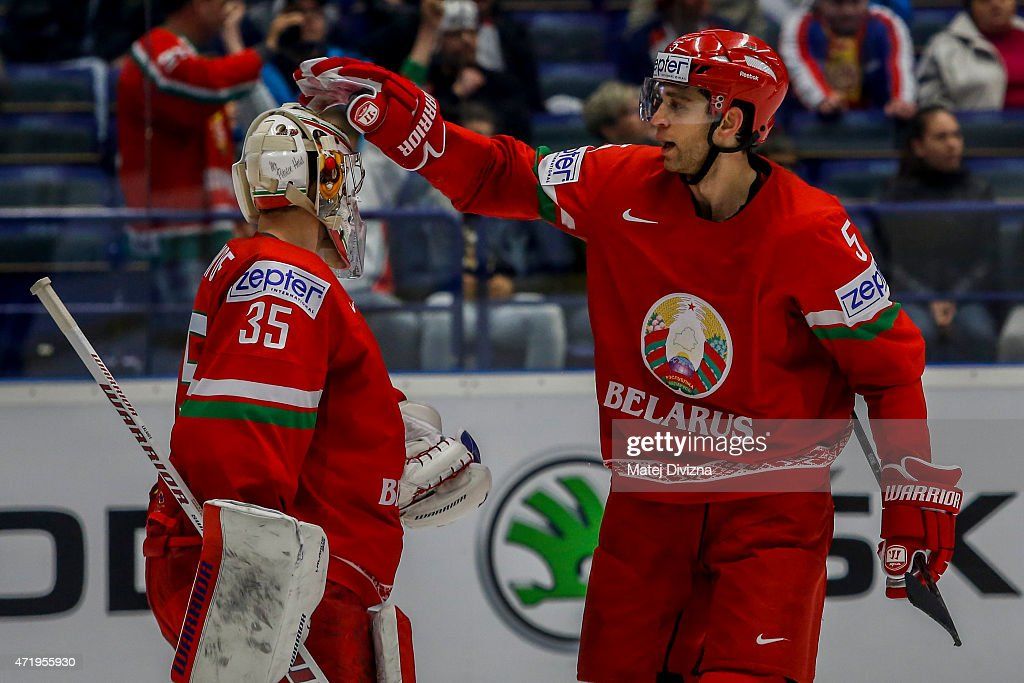 Kevin Lalande (L) and Nikolai Stasenko of Belarus celebrate after the IIHF World Championship group B match between Belarus and Slovenia at CEZ Arena on May 2, 2015 in Ostrava, Czech Republic.